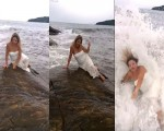 فيديو: موجة عملاقة تنتزع فتاة حاولت استعراض أنوثتها بالشاطئ