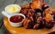 أجنحة الدجاج بصوص الترياكي